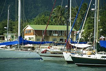 Yachts stern to quay, Avatiu Harbour, Rarotonga, Cook Islands, Pacific