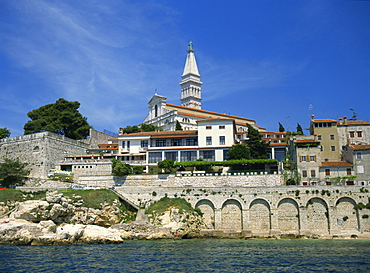 Waterfront and church of St. Euphemia from the west, at Rovinj, Croatia, Europe