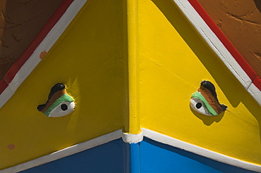 Close-up of a brightly coloured fishing boat (Luzzus) with the eye of Osiris to ward off evil at Marsaxlokk, a fishing village, Malta, Europe