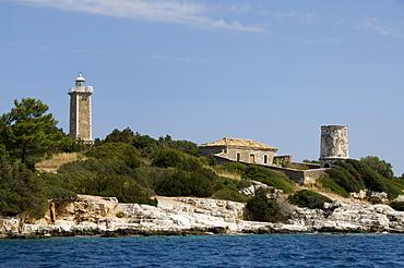 Lighthouse and old ruined lighthouse, Fiskardo, Kefalonia (Cephalonia), Ionian Islands, Greek Islands, Greece, Europe