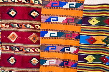 Traditional woven fabrics in tourist shops, Mitla, Oaxaca, Mexico, North America
