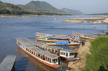 Tourist boats at the Pak Ou caves, Mekong River near Luang Prabang, Laos, Indochina, Southeast Asia, Asia