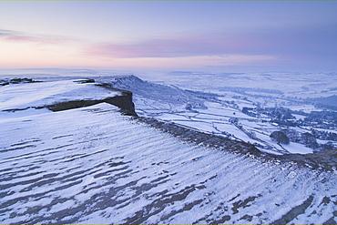 Snow at dawn, Froggatt Edge, Peak District, Derbyshire, England, UK