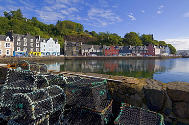 Multicoloured houses, and lobster pots on the jetty, in the harbour at Tobermory, Balamory, Mull, Inner Hebrides, Scotland, United Kingdom, Europe