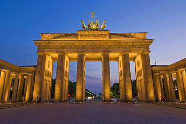 The Brandenburg Gate with the Quadriga winged victory statue on top illuminated at night, Pariser Platz, Berlin, Germany, Europe