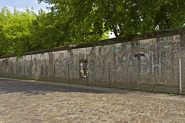 Part of the preserved section of the Berlin wall (Berliner mauer), on Zimmerstrasser near Checkpoint Charlie, Berlin, Germany, Europe