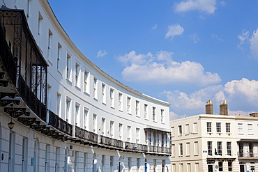 Terrace of Regency style Georgian houses with wrought iron balconies on The Royal Crescent, Cheltenham Spa, Gloucestershire, England, United Kingdom, Europe