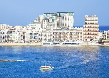 Sliema skyline, Marsamxett Harbour, and tourist boat, Valletta, Malta, Mediterranean, Europe