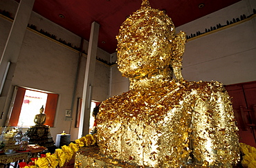 Thailand, Ayutthaya (Near Bangkok) Was The Siam Capital, Wat Yai Chai Mongkol Temple (Rebuilt In 1982), Close-Up On A Buddha Statue Gilted With Gold Leaves Offered By Believers