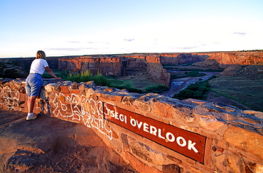 Usa, South West, Arizona, Canyon De Chelly, Navajo Reservation, Woman Looking At The Canyon From The Rim