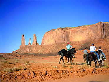 Usa, South West, Arizona & Utah, Navajo Reservation Of Monument Valley, The Three Sisters Red Rocks Peaks (Mesas), Tourist Visiting On Horseback