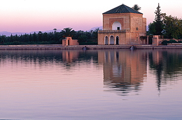 Morocco, South, Marrakech, La Menara Park, The Pavilion Reflected In The Lake At Dusk