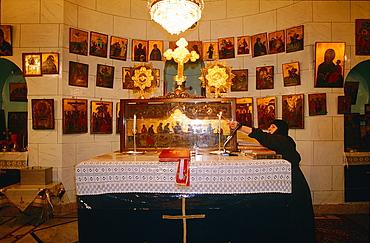 Syria, Qalamun, Saidnaya, Church Of The Notre Dame De Saidnaya, Greek Orthodox Monastery, Elderly Woman Lighting The Candles Before Mass