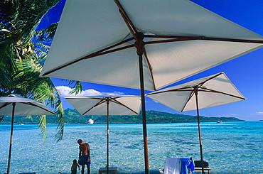 French Polynesia, Leeward Islands, Tahaa Island, Landscape And White Sunshades At Fore