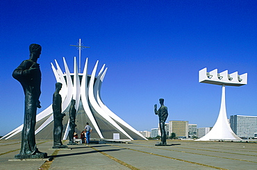 Brazil, Goias, Brasilia, The Administrative Capital Created Par President Kubitschek And Designed By Brasilian Town Planner Lucio Costa & Architect Oscar Niemeyer, The Cathedral And Row Of Statues Lining The Access