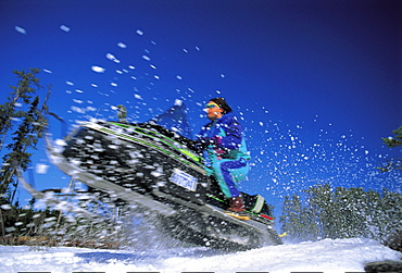 Snowmobile jumping in winter, Ontario, Canada, North America