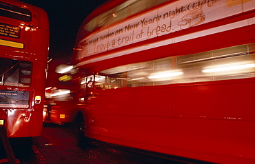 Double decker buses on Oxford Street at night, London, England, UK, Europe