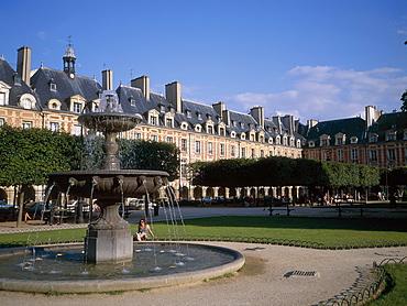 Place des Vosges and fountain, Paris, France, Europe