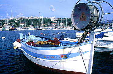 France, Corsica, Porto Vecchio, View Of The City From The Marina, Fishing Boat In Fore