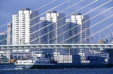 Netherlands, Rotterdam, Cargo Freighter Passing Under Erasmus Bridge