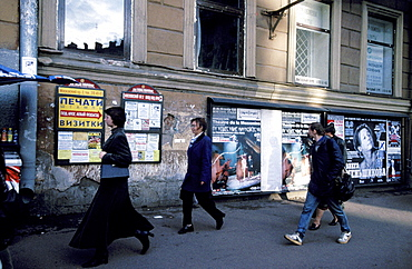 Russia, Saint Petersburg, Passers By, Ad Posters At Wall Behind
