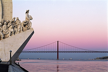 Monument to the Discoveries at Belem, and bridge across the Tagus River, Lisbon, Portugal, Europe