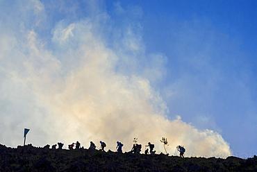 Trekkers approaching Stromboli volcano, Stromboli, Aeolian Islands, UNESCO World Heritage Site, Sicily, Italy, Mediterranean, Europe