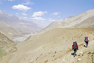 Two people trekking near KaGBeni, Southern Mustang, Nepal