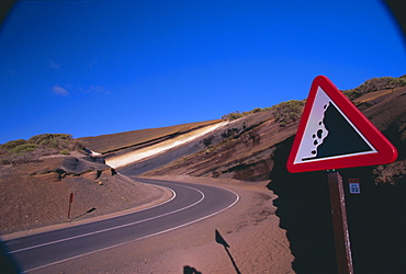Sign on a road with volcanic stratified rocks in the background, Parque Nacional del Teide, Tenerife, Canary Islands, Atlantic, Spain, Europe