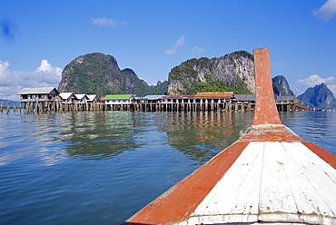 Stilt village seen from long tail boat, Phuket, Thailand