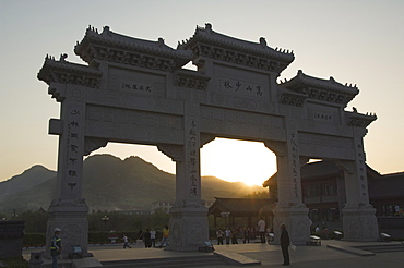 Sunset at the entrance gate to Shaolin temple, birthplace of Kung Fu martial art, Shaolin, Henan Province, China, Asia