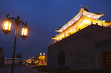 Illuminated City Gate and watch tower, UNESCO World Heritage Site, Qufu City, Shandong Province, China, Asia