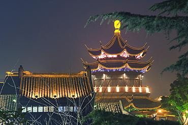 Pagoda and traditional architecture illuminated at night in Shantang water town, Suzhou, Jiangsu Province, China, Asia