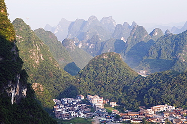 Karst limestone scenery surrounding a village in Yangshuo, near Guilin, Guangxi Province, China, Asia
