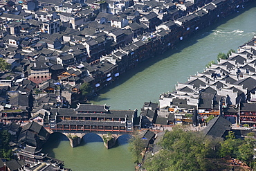 Looking down on a wind and rain bridge in the old town of Fenghuang, Hunan Province, China, Asia