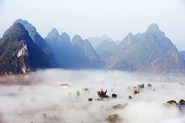 Morning mist covering the valley at Detian Falls, Guangxi Province, China, Asia