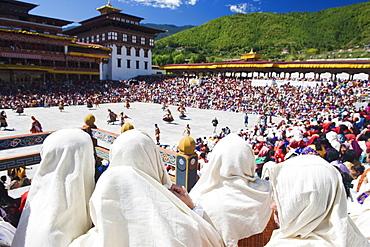 Spectators watching the Autumn Tsechu (festival) at Trashi Chhoe Dzong, Thimpu, Bhutan, Asia