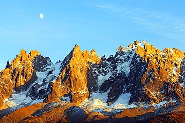 Moon rising over Aiguilles des Chamonix, Chamonix, Rhone Alps, Haute Savoie, France, Europe