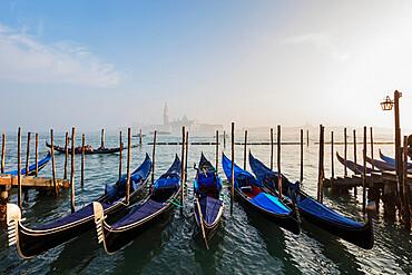 Gondola and San Giorgio Maggiore Church across Basino di San Marco, Venice, UNESCO World Heritage Site, Veneto, Italy, Europe