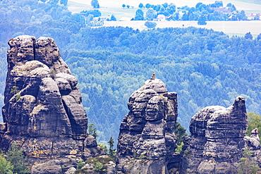 Rock climbers at Schrammsteine, Swiss Saxon National Park, Saxony, Germany, Europe