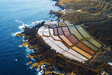 Aerial view of the salt pans and lighthouse at Faro de Fuencaliente. UNESCO Biosphere Site, La Palma, Canary Islands, Spain, Atlantic, Europe