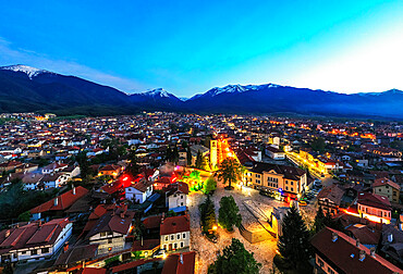 Aerial view by drone of Bansko old town and Pirin National Park, UNESCO World Heritage Site, Bankso, Bulgaria, Europe