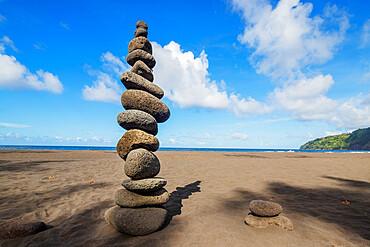 Waipio valley north shore, rocks stacked on the beach, Big Island, Hawaii, United States of America, North America