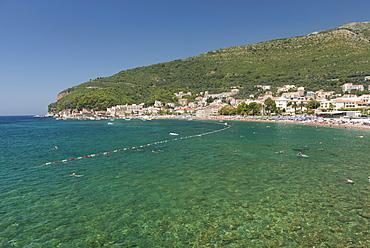 People swimming in Adriatic Sea, resort town of Petrovac, Montenegro, Europe