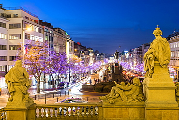 Christmas decorations and markets through statues of National Museum at Wenceslas Square, New Town, Prague, Czech Republic, Europe