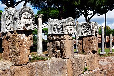 Traditional theatre masks, Ostia Antica, Lazio, Italy, Europe