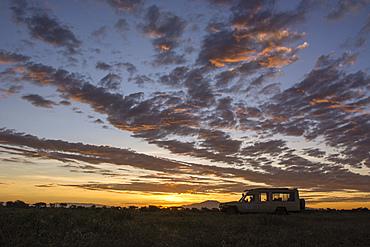 A safari vehicle at sunrise in Ndutu, Serengeti, UNESCO World Heritage Site, Tanzania, East Africa, Africa