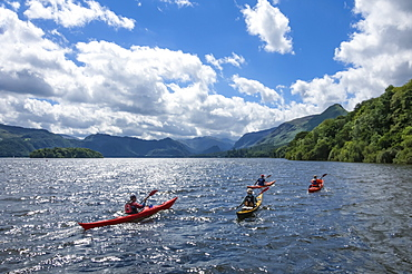 Canoes on Derwentwater, view towards Borrowdale Valley, Keswick, Lake District National Park, Cumbria, England, United Kingdom, Europe