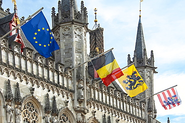 The 14th cenury Stadhuis (City Hall) with National and Regional Flags, Burg Square, Brugge (Bruges), UNESCO World Heritage Site, West Flanders, Belgium, Europe