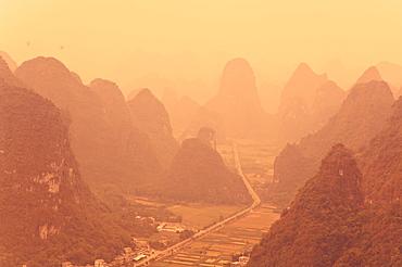 Karst landscape and morning haze, Yangshuo, Guangxi Province, China, Asia